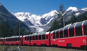 Cars of the Rhaetische Bahn near the Morteratsch station of the Bernina Railway