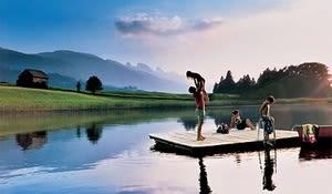 A family at lake Schoenenboden (1097 m) near Wildhaus in the Toggenburg valley, Eastern Switzerland. In the background the Churfirsten.