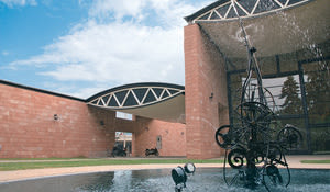 The Museum Tinguely in Basel by Mario Botta. The sculpture 'Gwendolyn' by Niki de Saint Phalle.